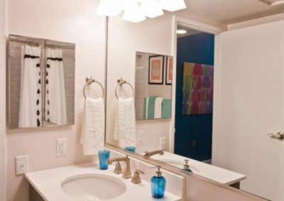 apartment bathroom with wall-to-wall mirror at Chocolate Works in Philadelphia