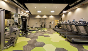 MetroFit Reinhold Residential's apartment fitness center with cardio and weights in Philadelphia