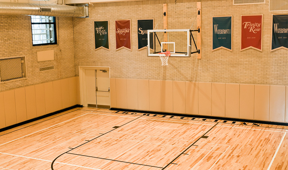 Historic 1920s gymnasium with basketball court in The Metropolitan in Philadelphia