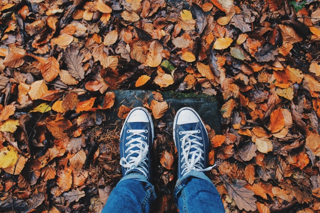 feet and autumn leaves
