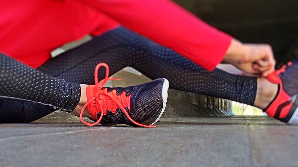 Close up of person wearing athletic shoes and pants before a workout