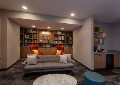 chocolate-works-common-area-sofa-with-books