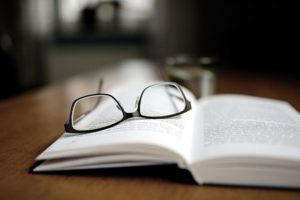 pair of glasses on book