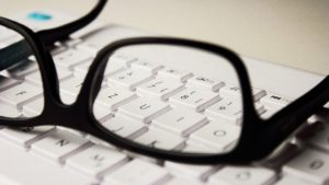 pair of glasses on keyboard