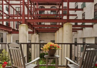 Private apartment balcony facing the interior courtyard at Chocolate Works apartments