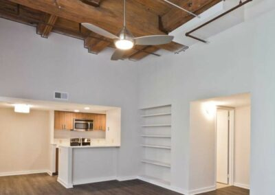 Exposed wood beams and hardwood floors in a Chocolate Works Old City apartment